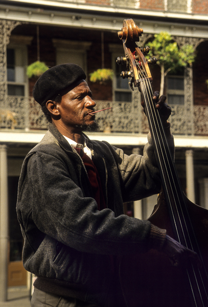 Louisiana: New Orleans, Jackson Square, African-American male string-bass player, December © Alison M. Jones