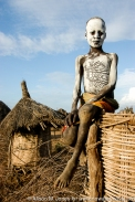 Ethiopia: Omo River Valley, Karo village of Lebuk, Karo Man with traditional white clay body paint
