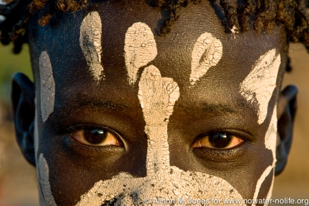 Ethiopia: Lower Omo River Basin, Lebuk, a Karo village, during dancing ceremony, portrait of boy with face paint