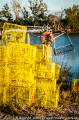 USA: Louisiana, the Atchafalaya Basin, Terrabonne Parish, Cocodrie, Life vest and shellfishing traps, tongs and net on Bayou Petit Caillou