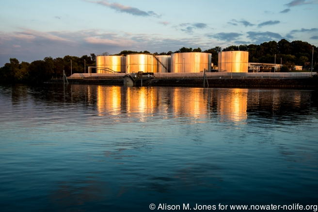 USA: Tennessee, Appalachia, Tennessee River Basin, Knoxville, fuel storage tanks on Tennessee River, sunset