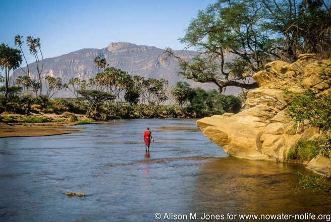 Kenya: Shaba National Reserve, Maasai moran in Ewosa Nyiro River