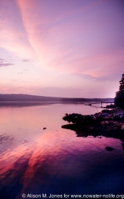 USA: Maine, sunset over lake
