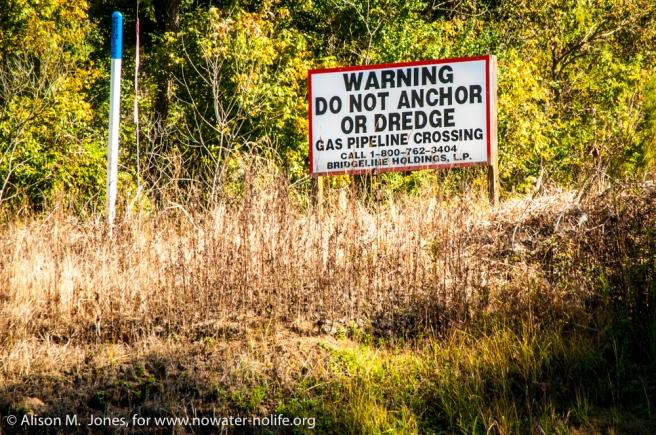 USA: Louisiana, the Atchafalaya Basin, with C. C. Lockwood, on Jakes Bayou, off the Atchafalaya River, sign for gas pipeline